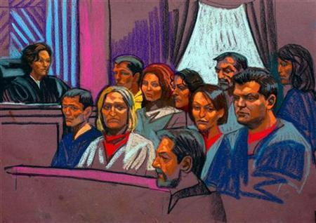 Russian spy suspects are seen in this courtroom sketch during their appearance in Manhattan Federal Court in New York, July 8, 2010. REUTERS/Christine Cornell