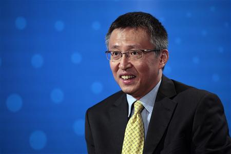 Geely Executive Directors Lawrence Ang speaks during the Reuters Global Auto Summit in Hong Kong November 11,2010. REUTERS/Tyrone Siu