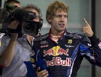 <p>Sebastian Vettel da Red Bull comemora pole position para o GP de Abu Dhabi. REUTERS/Steve Crisp</p>