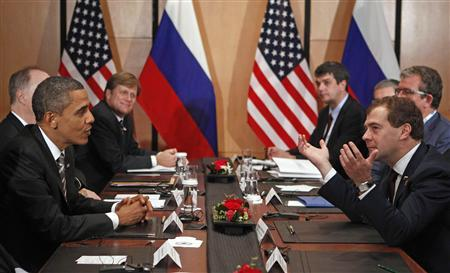 President Barack Obama meets Russia's President Dmitry Medvedev at the APEC Summit in Yokohama November 14, 2010. REUTERS/Jim Young