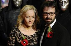 """<p>Britain's J.K. Rowling and husband Neil Murray pose as they arrive for the world premiere of """"Harry Potter and the Deathly Hallows: Part 1"""" at Leicester Square in London November 11, 2010. REUTERS/Dylan Martinez</p>"""