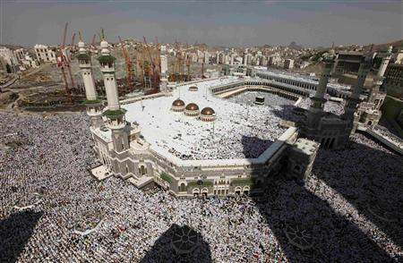 Muslim pilgrims attend Friday prayers at the Grand mosque in Mecca, November 12, 2010, during the annual haj pilgrimage. The haj is one of the world's biggest displays of mass religious devotion and a duty for Muslims who can perform it. REUTERS/Mohammed Salem