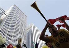 <p>A Brazilian fan blows a vuvuzela as he celebrates after Brazil scored a goal against the Netherlands during the 2010 World Cup quarter-final soccer match in Sao Paulo July 2, 2010. REUTERS/Nacho Doce</p>
