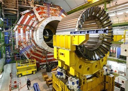 A technician walks under the core magnet of the CMS (Compact Muon Solenoid) experiment at the European Organization for Nuclear Research CERN (Centre Europeen de Recherche Nucleaire) in the French village of Cessy, near Geneva March 22, 2007. CMS is part of five experiments which will study what happens when beams of particles collide in the 27 km (16.8 miles) long underground ring LHC (Large Hadron Collider). REUTERS/Denis Balibouse