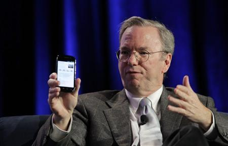 Google CEO Eric Schmidt holds a prototype of the Android Gingerbread smartphone during the Web 2.0 Summit in San Francisco, California November 15, 2010. REUTERS/Robert Galbraith