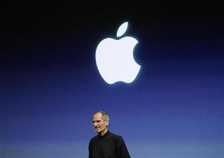 Apple Inc. CEO Steve Jobs smiles at the end of the iPhone OS4 special event at Apple headquarters in Cupertino, California in this April 8, 2010 file photo. REUTERS/Robert Galbraith