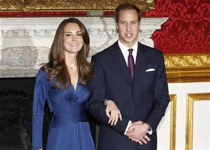 Britain's Prince William and his fiancee Kate Middleton (L) pose for a photograph in St. James's Palace, central London November 16, 2010. REUTERS/Suzanne Plunkett