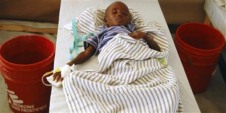 A cholera victim awaits treatment inside a hospital run by Doctors Without Borders in Port-au-Prince November 15 , 2010. REUTERS/St-Felix Evens