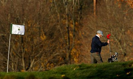 A golfer is pictures on the course at the Merion Golf club in Haverford, Pennsylvania, November 17, 2010. Securities experts said there's nothing inherently wrong with a hedge fund organizing small golf outings for its traders and analysts to meet with corporate executives in order to get to know a company or an industry better. That is the kind of fundamental research and basic information gathering that often separates one hedge fund from the other. REUTERS/Tim Shaffer