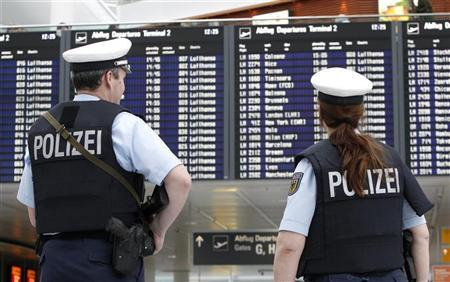 A German police officers patrol the departure area of Munich's airport November 18, 2010. REUTERS/Michaela Rehle