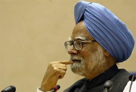 Prime Minister Manmohan Singh listens to a question during his annual news conference in New Delhi in this February 1, 2006 file photo. REUTERS/Kamal Kishore
