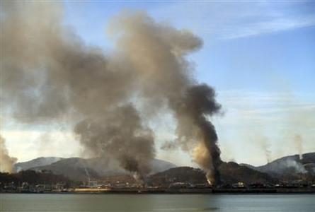 Smoke rises from South Korean Yeonpyeong Island after being hit by dozens of artillery shells fired by North Korea November 23, 2010 in this picture taken by a South Korean tourist. REUTERS/Yonhap