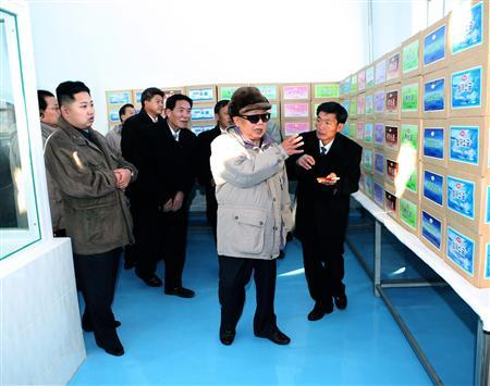 North Korean leader Kim Jong-il (2nd L) and his son Kim Jong-un (L) visit the newly-built Soy Sauce Shop at the Ryongsong Foodstuff Factory in North Korea, in this undated picture released by North Korea's official KCNA news agency on November 24, 2010. REUTERS/KCNA