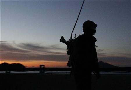A South Korean marine patrols on Yeonpyeong island November 26, 2010. REUTERS/Jo Yong-Hak