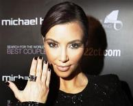 <p>Reality TV star Kim Kardashian models a 22 karat princess cut diamond ring during the launch of the Michael Hill Jeweller's Ultimate Engagement Ring Search for the World's Best Couple in Toronto October 18, 2010. REUTERS/Mike Cassese</p>