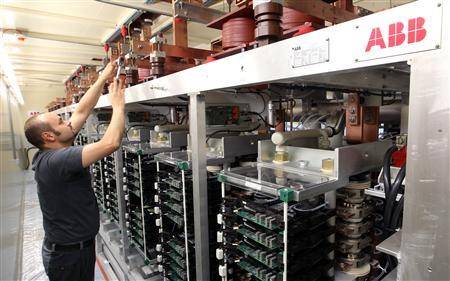 File picture shows a technician preparing a power converter at a plant of Swiss engineering group ABB in the town of Turgi west of Zurich June 9, 2010. REUTERS/Arnd Wiegmann/File