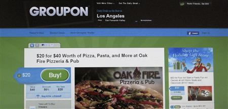 An online coupon sent via email from Groupon is pictured on a laptop screen November 29, 2010 in Los Angeles. Google Inc is reportedly closing in on a deal to buy online discount-coupon sensation Groupon for up to $6 billion in its largest-ever acquisition, signaling a willingness to use some of its huge cash hoard to buy growth. REUTERS/Fred Prouser
