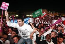 <p>Qatari fans celebrate at Souk Waqif in Doha December 2, 2010, after the announcement that Qatar will host the 2022 World Cup. REUTERS/Fadi Al-Assaad</p>