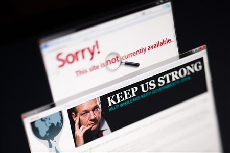 A screen shot of a web browser shows the wikileaks.ch home page with a portrait of WikiLeaks founder Julian Assange next to the out of service wikileaks.com domain, in Lavigny December 4, 2010. REUTERS/Valentin Flauraud