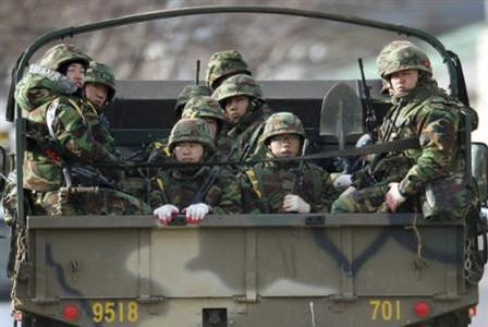 South Korean marines look out from a truck on Yeonpyeong Island, near the western maritime border between the two Koreas December 6, 2010. REUTERS/Kim Hyun-tae/Yonhap