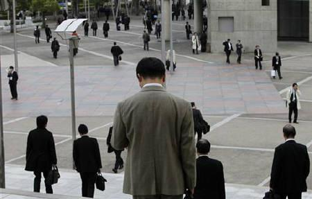 People walk in a business district in Chiba, east of Tokyo December 2, 2010. REUTERS/Toru Hanai