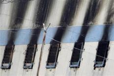 <p>Окна пятого сектора тюрьмы Сан-Мигель в Сантьяго после пожара 8 декабря 2010 года. Пожар в тюрьме в столице Чили Сантьяго унес жизни как минимум 81 человека, сообщило государственное телевидение со ссылкой на представителей тюрьмы. REUTERS/Ivan Alvarado</p>