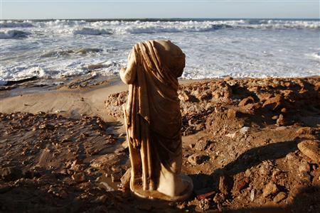 A Roman statue stands on the shore of the Mediterranean sea in the southern city of Ashkelon December 14, 2010. REUTERS/Amir Cohen