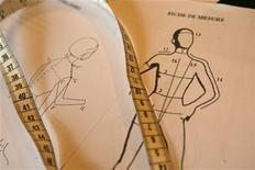 "<p>A tape measure and costume fitting diagrams are seen during a cast costume measurements meeting for ""Cabaret"" in Paris June 19, 2006. REUTERS/Philippe Wojazer</p>"