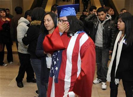 Students, some wearing graduation caps and gowns, cry after watching from the senate gallery as opponents block passage of the ''Dream Act'' at the U.S. Capitol in Washington, December 18, 2010.REUTERS/Jonathan Ernst