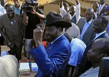 <p>South Sudan's President Salva Kiir shows his inked finger as he arrives at a polling station in Juba, south Sudan, April 11, 2010. Sudan holds historic multi-party elections on Sunday that have been marred already by fraud allegations and will test the fragile unity of a nation divided by decades of civil conflict. REUTERS/Goran Tomasevic</p>