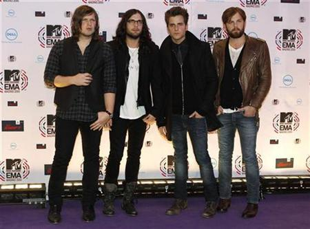 Members of the U.S. band Kings of Leon (L-R) Matthew Followill, Nathan Followill, Jared Followill and Caleb Followill pose for photographers as they arrive for the MTV Europe Music Awards 2010 in Madrid November 7, 2010. REUTERS/Susana Vera