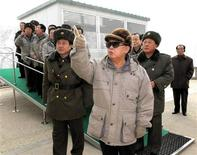 <p>North Korean leader Kim Jong-il (front) visits the construction site of the Huichon Power Station in this undated picture released by North Korea's official KCNA news agency in Pyongyang on December 23, 2010. REUTERS/KCNA</p>