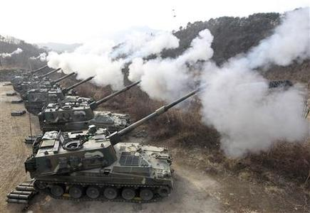 South Korea K-9 self-propelled guns fire live rounds during air and ground military exercises on the Seungjin Fire Training Field, in mountainous Pocheon December 23, 2010. REUTERS/Park Ji-Ho/Yonhap
