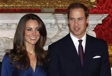 <p>Britain's Prince William and his fiancee Kate Middleton (L) pose for a photograph in St. James's Palace, central London November 16, 2010. an end. REUTERS/Suzanne Plunkett</p>