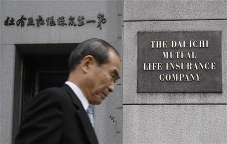 A man walks past the sign of Dai-ichi Mutual Life Insurance at its headquarters in Tokyo March 19, 2010. REUTERS/Kim Kyung-Hoon
