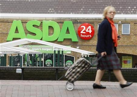 A shopper walks past an Asda superstore in south London, August 13, 2009. REUTERS/Luke MacGregor