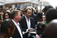 <p>Cast member Nicolas Cage signs autographs in New York in this July 6, 2010 file photo. REUTERS/Eric Thayer</p>