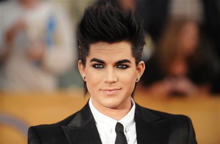 Singer Adam Lambert arrives at the 16th annual Screen Actors Guild Awards in Los Angeles in this January 23, 2010 file photo. News organizations had the most influence on the top Twitter topics in 2010 but some celebrities were not far behind, according to new research. NPR News, The New York Times, Times.com and The Wall Street Journal were often the top influencers on politics and world events, but celebrities like Adam Lambert also had an impact. REUTERS/Phil McCarten/Files