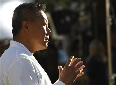 Peter Rhee, medical director of the University Medical Center's Trauma and Critical Care unit, where U.S. congresswoman Gabrielle Giffords is now treated, talks to reporters at a memorial outside the hospital in Tucson, Arizona January 10, 2011, where victims of last Saturday's shootings are recovering. REUTERS/Rick Wilking