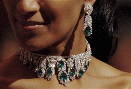 An emerald and diamond necklace and ear pendants are auctioned during a jewellery sale by Christie's in Dubai, April 29, 2008. The set was sold for the final price of $241,000. REUTERS/Jumana El Heloueh
