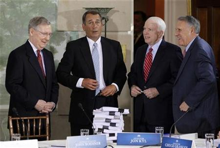 Republican lawmakers (L-R) Senate Minority Leader Mitch McConnell (R-KY), House Minority Leader John Boehner (R-OH), Senator John McCain (R-AZ) and Senate Republican Whip Jon Kyl (R-AZ) gather in front of health reform documentation at the start of a health reform summit with U.S. lawmakers and U.S. President Barack Obama at Blair House in Washington, February 25, 2010. REUTERS/Jason Reed