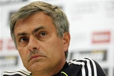<p>Real Madrid's coach Jose Mourinho attends a news conference at the Valdebebas training grounds outside Madrid November 28, 2010, on the eve of their Spanish First Division soccer match against Barcelona. REUTERS/Juan Medina</p>