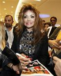 <p>Singer La Toya Jackson, sister of the late Michael Jackson, signs autographs for fans at The Point mall in Sliema at Valletta's Marsamxett Harbour, April 14, 2010. REUTERS/Darrin Zammit Lupi</p>