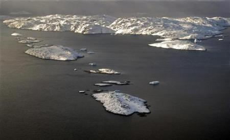 The snow-covered landscape is seen in an aerial photo near the town of Uummannaq in western Greenland March 17, 2010. REUTERS/Svebor Kranjc
