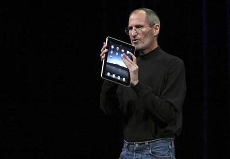 Apple Chief Executive Officer Steve Jobs holds the new '' iPad'' during the launch of Apple's new tablet computing device in San Francisco, California, January 27, 2010. REUTERS/Kimberly White