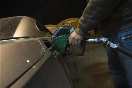 EDITORS' NOTE: Reuters and other foreign media are subject to Iranian restrictions on their ability to film or take pictures in Tehran. An Iranian man pumps fuel into his car at a petrol station in northwestern Tehran December 19, 2010. REUTERS/Morteza Nikoubazl