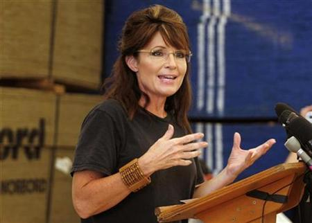 Former Alaska governor Sarah Palin speaks to reporters at a storage area containing supplies for shelters run by Samaritan's Purse, a charity associated with the ministries of U.S. evangelist Billy Graham, in Cabaret December 12, 2010. REUTERS/Kena Betancur