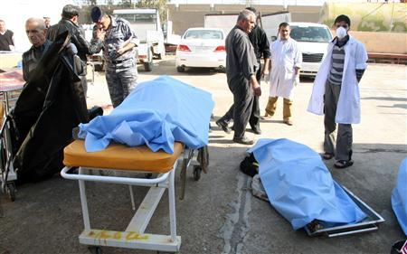 Bodies of bomb attack victims are seen outside a hospital in Tikrit, some 150 km (95 miles) north of Baghdad, January 18, 2011. A suicide bomber wearing a vest filled with explosives attacked Iraqi police recruits on Tuesday in former dictator Saddam Hussein's hometown of Tikrit, killing at least 42 and wounding over 100, officials said. REUTERS/Sabah al-Bazee