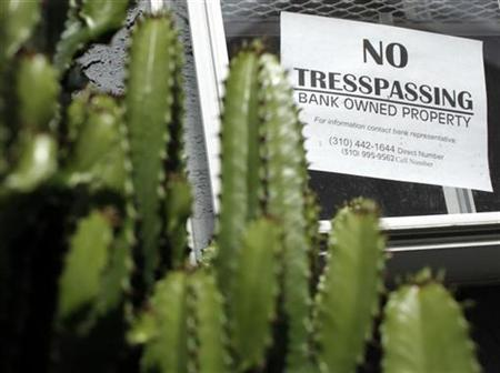 A sign on a foreclosed home is seen in Los Angeles, California, October 25, 2010. REUTERS/Lucy Nicholson