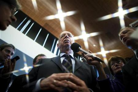 Klaus Schwab, founder and Executive Chairman of the World Economic Forum (WEF) answers journalists questions after a news conference at the WEF headquarters in Cologny near Geneva January 19, 2010. The 2011 Annual Meeting will take place January 26 to 30. Picture taken with a star filter. REUTERS/Valentin Flauraud